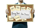 Business man holding board on the background, Bring your own device — Stock Photo