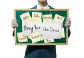 Business man holding board on the background, Bring your own device — Stok fotoğraf
