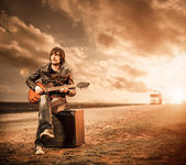 Sunset guitarist — Stock Photo