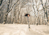 Active woman at winter forest — Stock fotografie