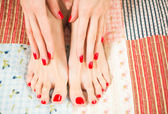 Female feet with red nails — Stock Photo