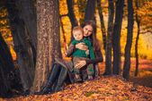 Mother with son at fall forest — Stock Photo