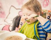 Boy eating soup — Stock Photo