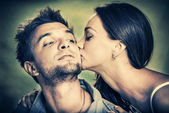 Woman kissing her man — Stock Photo