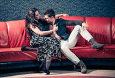Lovers on a sofa — Stock Photo