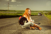 Redhead woman with gutar — Stock Photo
