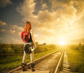 Woman with guitar at railway — Stock Photo