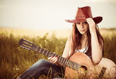 Woman with guitar at spring grass — Stock Photo