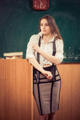 Young teacher at classroom — Stockfoto