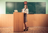 Sexy teacher at classroom — Stockfoto