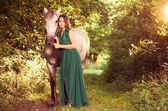 Woman with horse at forest path — Photo