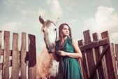 Woman at farm sunset with white horse — ストック写真