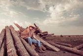 Cowboy at sunset lumbers — Stock Photo
