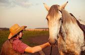 Cowboy and horse at sunset — Stock Photo