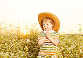 Boy in hat at buckwheat — Stock Photo
