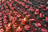 Red Candle Offereings — Stock Photo