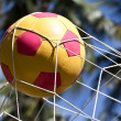 Stock Photo: Soccer ball in goal