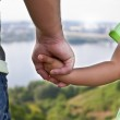 The hands of the father and child — Stock Photo #27180213