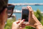 Woman using phone camera — Stock Photo