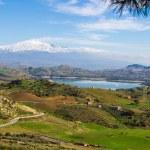 View from Agira of Pozzillo Lake, on background volcano Etna — Stock Photo #32545937