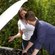 Stock Photo: Mechanic repairing car