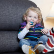 Stock Photo: A male child on the sofa