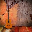 Old guitar with vintage room  — Stock Photo