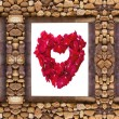 Stock Photo: I love you word made from red rose petals in stone frame