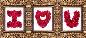 I love you word made from red rose petals in stone frame — Stock Photo