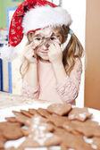 Girl in santas hat — Stock Photo