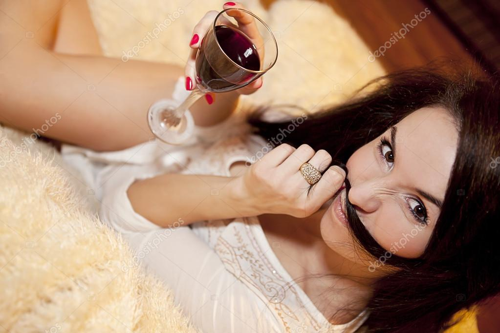 A girl with glass of wine making funny faces  Stock Photo #19710129