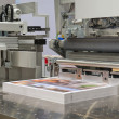 Cutting machine in a print shop — Stockfoto