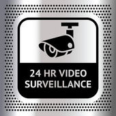Video surveillance symbol on a metallic chromium background — Stock Vector