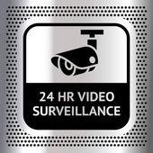Video surveillance symbol on a metallic chromium background — Stock Vector