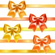 图库矢量图片: Golden and bronze bows of silk ribbon