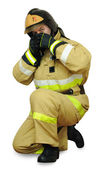 Fireman covers his face — Stock Photo