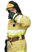 Firefighter protects face with his hand — Stock Photo