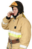 Firefighter drinking black tea — Stock Photo