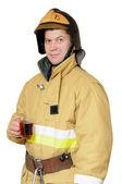 喝着一杯红茶的消防员 — 图库照片