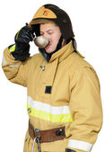 Hungry firefighter — Stock Photo