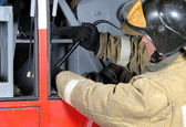 Firefighter gets crowbar — Stock Photo