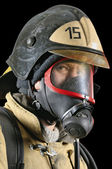 Firefighter in breathing apparatus — Stock Photo
