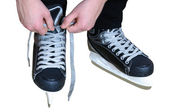 Tying laces on hockey skates — Stock Photo