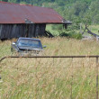 Stok fotoğraf: Old Barn and Truck in Field