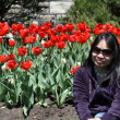 Woman by Tulips — Stock Photo