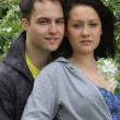 Stock Photo: Young Couple Among Blossoms