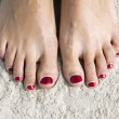 Stock Photo: Red toenails