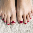 Red toenails - Stock Photo