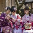 Three japanese girls in kimono — Stock Photo