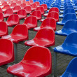 Red and blue stadium seats — Stock Photo